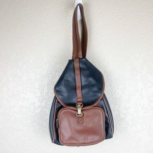 Vintage leather convertible sling backpack